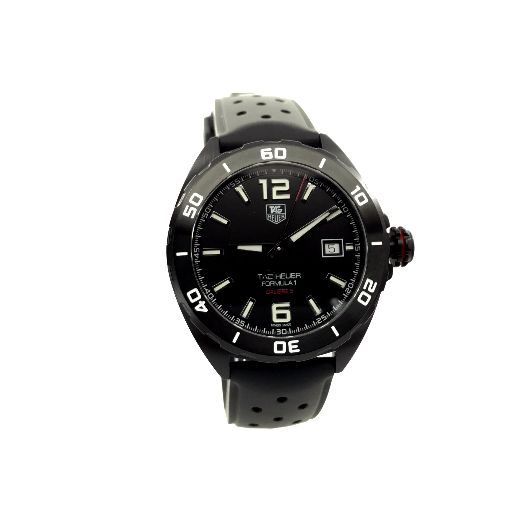 6b8d20428ff1 Black titanium carbide coated steel case with a black rubber strap.  Uni-directional rotating black titanium carbide coated steel bezel. Black  dial with ...